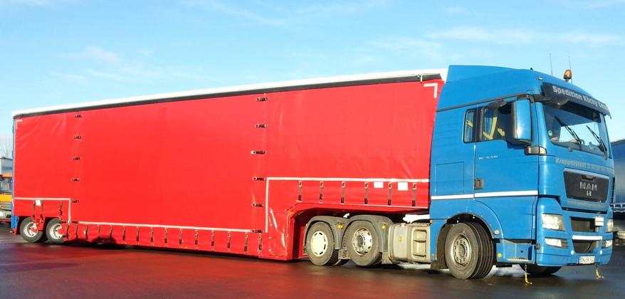DINKEL – Tiefbett - Sattelauflieger in Zweiachsachsausführung, mit hydraulischer Zwangslenkung, vorderer, hinterer Fahrgestellkröpfung und hydraulischer Verbreiterung, Typ DSATMV 42000
